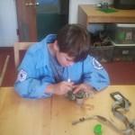 Caleb doctoring electronics
